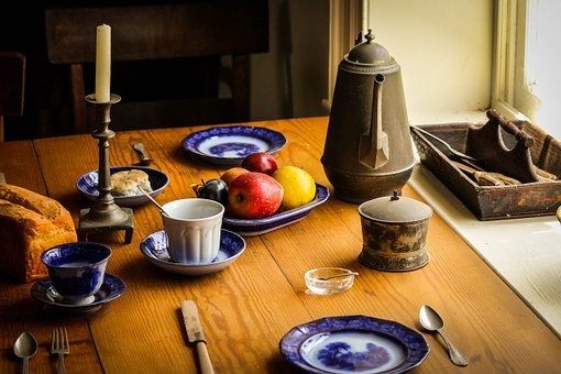 table, teapot, plates, candle