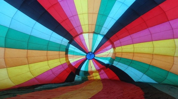 hot air balloon on ground rainbow colours
