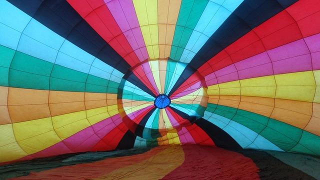 hot air balloon on ground rainbow colours