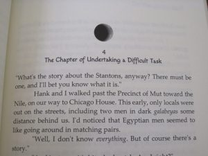 She Who Comes Forth book chapter heading with moon glyph