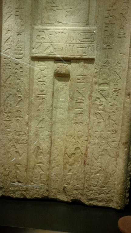 Old Kingdom false door, made of limestone with hieroglyph inscriptions, from RBCM Egypt exhibit.