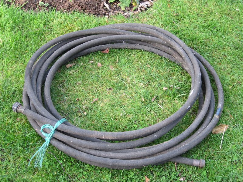 Old black rubber soaker hose coiled up