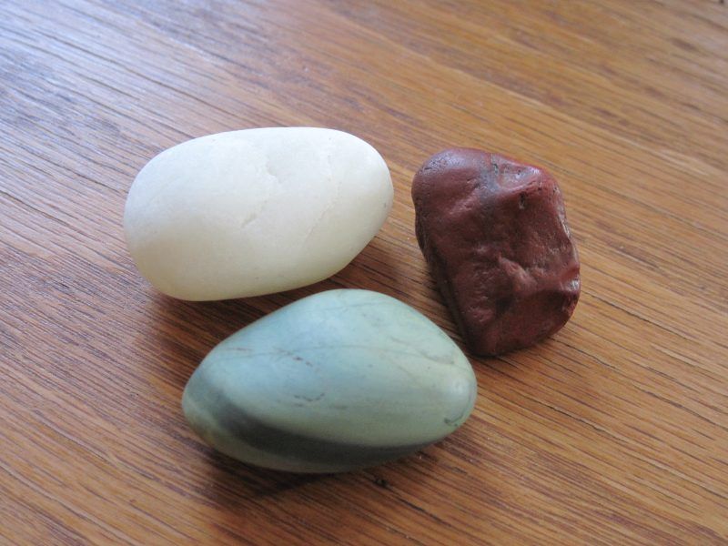 White quartz, bright red rock (jasper?) and bright green rock (nephrite?) with darker green stripe