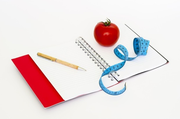 Notebook, tomato, tape measure, diet