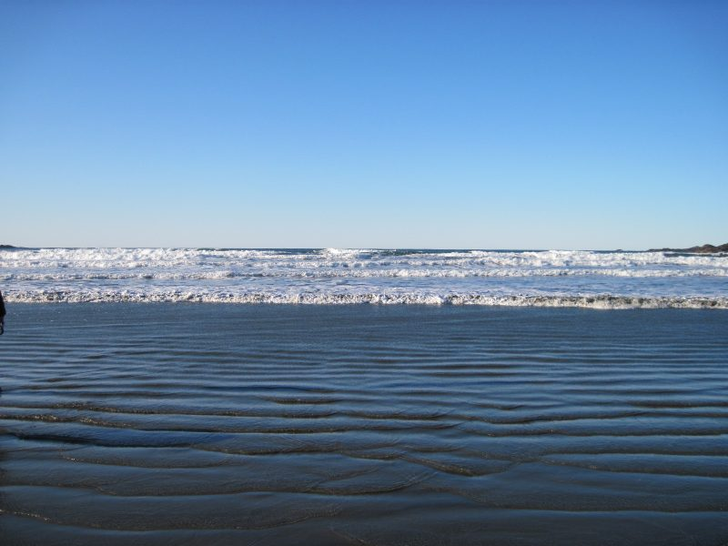 Waves and rippled sand at Cox Bay, near Tofino
