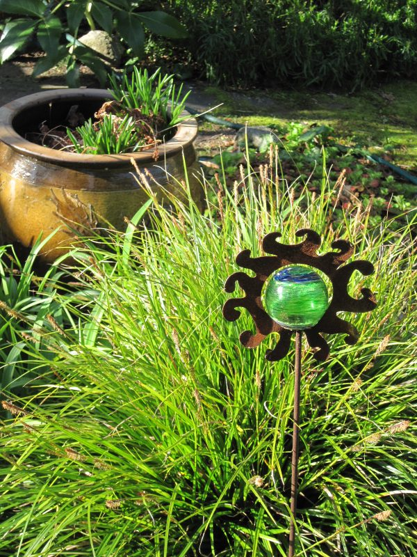 Sedge, Carex and garden ornament