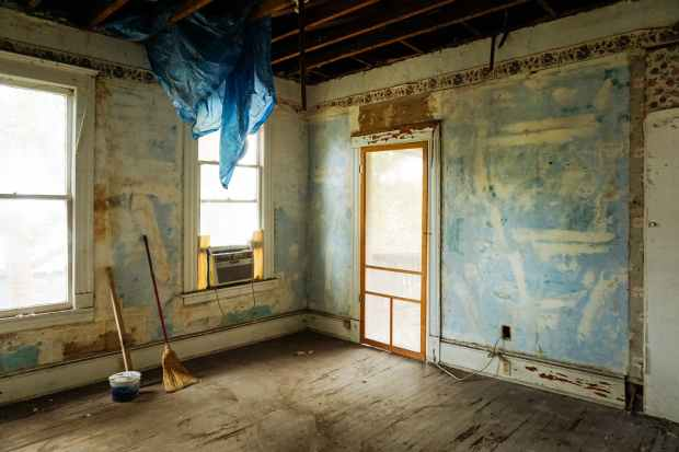 stripped-down room, renovations in progress