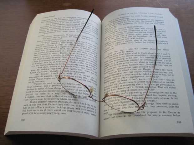 My copy of Islands of the Gulf Volume 1, The Journey and my glasses