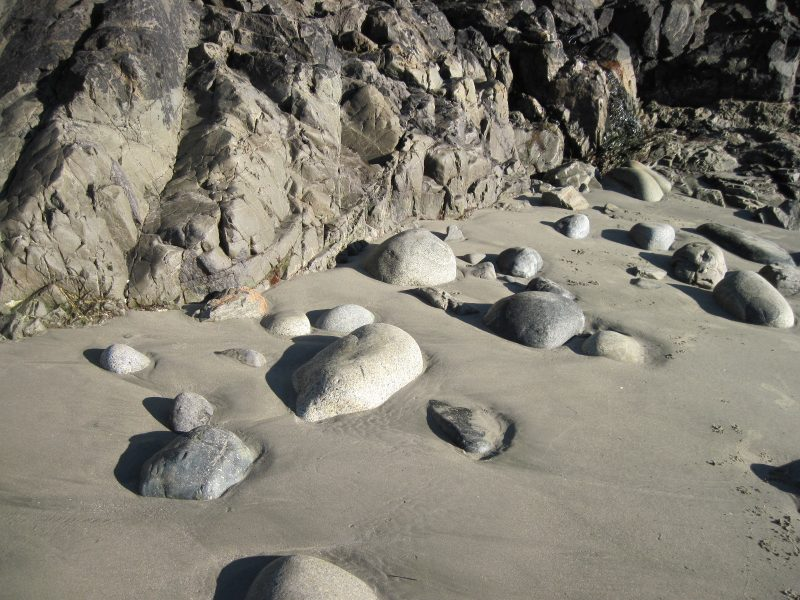 Water-worn boulders and bedrock Cox Bay